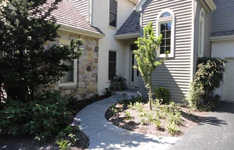 Landscaping and stone walkway in front of home